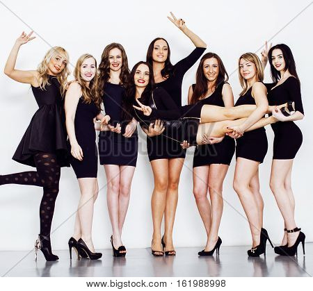 Many diverse women in line, wearing fancy little black dresses, party makeup, vice squad concept lifestyle