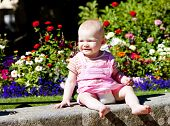 baby girl sitting in the garden