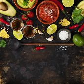 Mixed mexican food background. Party food. Guacamole,nachos, salsa, peppers, tomatoes, avocado and t poster
