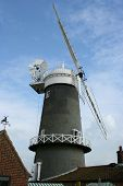 pic of fantail  - Old tower type windmill showing sails and fantail used for producing flour - JPG