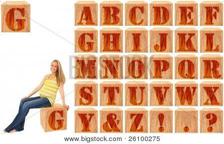 Wood engraved and stained alphabet blocks.  Featuring pregnant woman on Letter G.