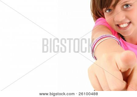 Beautiful 10 year old girl pointing up to camera over white background.
