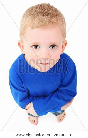 Adorable 2 year old boy looking up at camera over white background.  Top view.