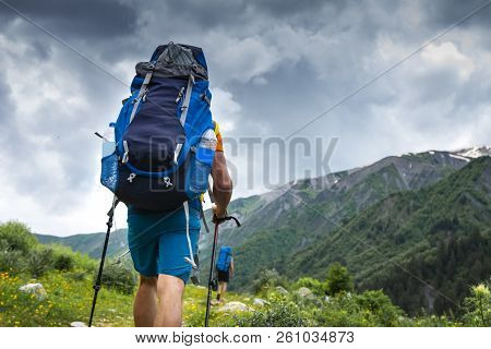 Tourist With Backpack Hike On