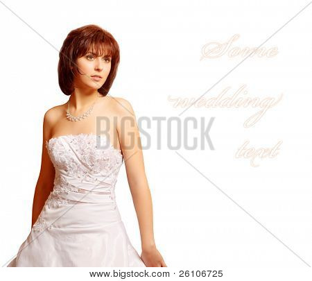 Slim beautiful woman wearing luxurious wedding dress standing alone. Text field. Isolated on white.