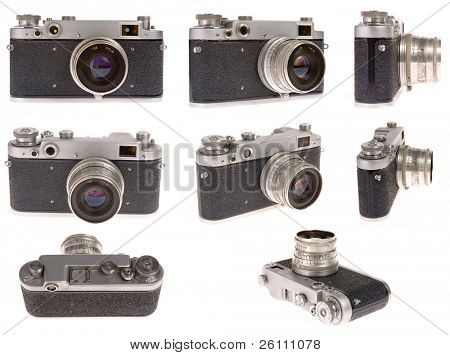 old photo camera in eight position on white background