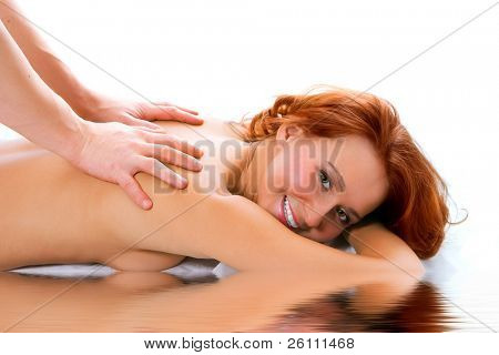 man hand massage beauty redheaded girl on white background
