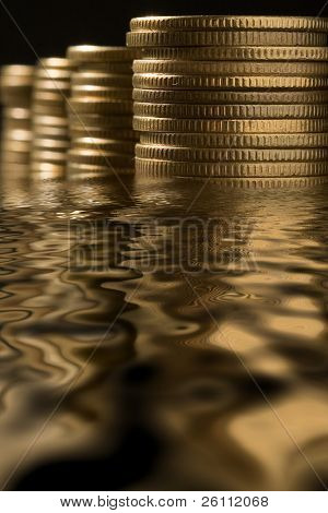 money in water with reflection
