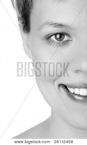 close-ups Half face girl looks in staff and widely smiles a white teeth over white background