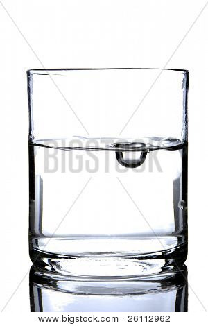 glass with water and bubble over white background