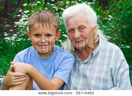 boy and grandmother in garden