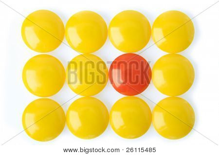 red and yellow tablets on white background