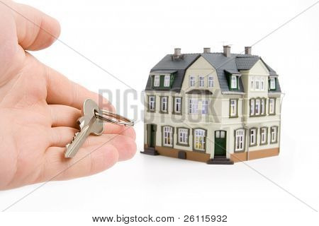 hand with key for house over white background