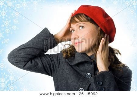 girl in outer clothing  beret and snowflake