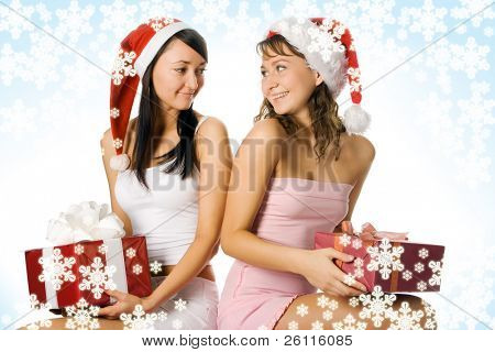 beauty christmas girls in red hat with box gift over white background