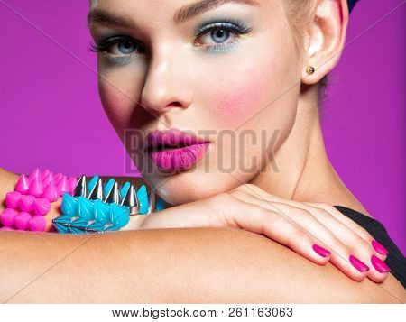 poster of Closeup portrait of a beautiful fashion woman with bright makeup.  Gorgeous glamour girl of an attra