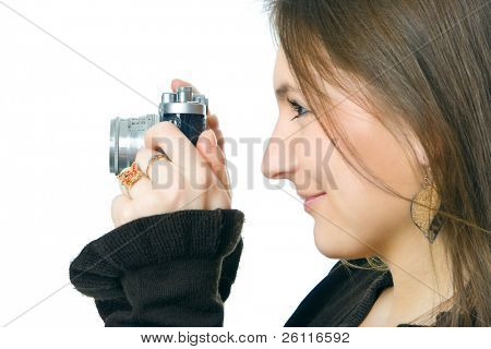 woman photographer with camera over white