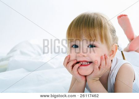little girl have fun in bed