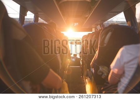 poster of Background, Bus Interior. The Salon Of The Bus With People Fill The Sun With Light In The Sunset. Pe