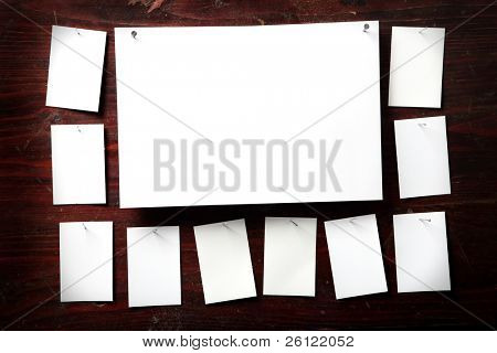 Photo paper attach nail wooden background