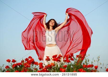 beauty woman in poppy field with tissue