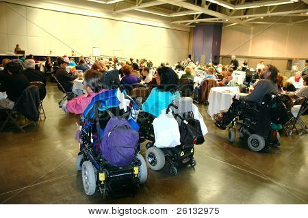 Attendees at a conference for seniors and persons with disabilities issues