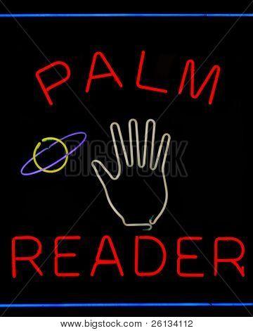 Illuminated palm reader neon sign on black