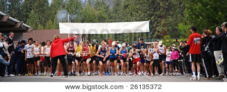 SOUTH LAKE TAHOE, CA - JUNE 14: Runners at the starting line take off after gun fires at the DeCelle Memorial Lake Tahoe Relay race June 14, 2009 in South Lake Tahoe, California