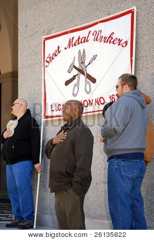 SACRAMENTO, CALIFORNIA - FEBRUARY 26: Members of Sheet Metal Workers Union recite Pledge of Allegiance at rally held at the California State Capitol on February 26, 2011 in Sacramento, California