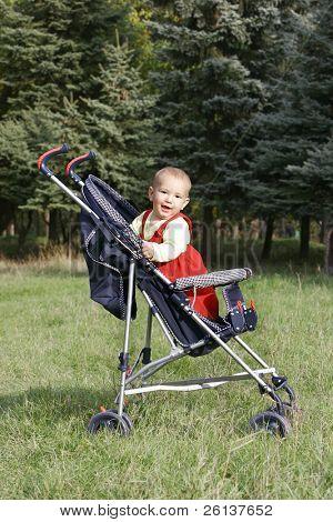 smiling baby boy in stroller
