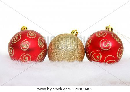 christmas balls on snow over white
