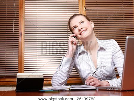 attractive business woman at working place