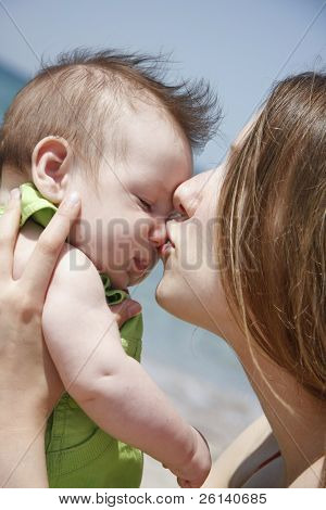 close up of loving mother and baby on nature