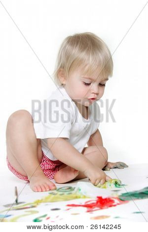 cute toddler girl painting over white