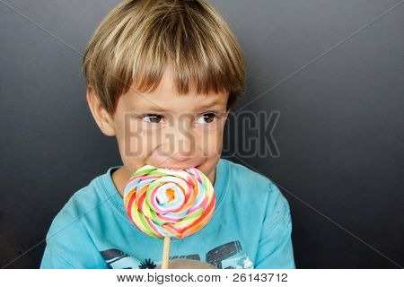 young boy with colorful lollipop