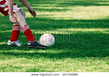 Minor league soccer, with a player kicking the ball