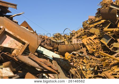 Heaps of different kinds of metal scrap in a scrap yard