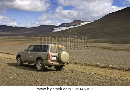 A four by four car parked to observe the magnificent Icelandic Highland scenery of the Sprengisandur Tundra