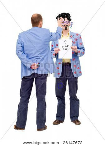 Conceptual image about making fun out of oneself. Can be used to illustrate self-mockery, or social issues such as bullying at work.