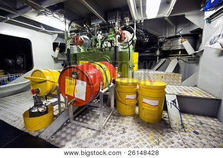 The engine room with the oil pump for lubrication of a tugboat