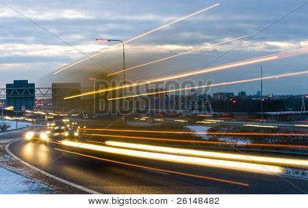 Truck passing by on a motorway junction on a winter evening