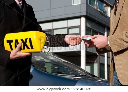 A government official handing a taxi license and sign to a newly appointed taxi driver