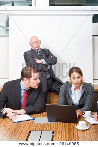Boss and businessman looking down in contempt on a secretary for messing up
