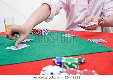 A man dealing cards during a poker game