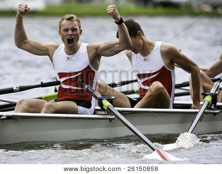 AMSTERDAM-JULY 23: Noemlem and Nielsen (Denmark BLM4x) Cheer in viking style as they  win the gold medal at the world championships under 23. On July 22, 2011 in Bosbaan, Amsterdam, The Netherlands