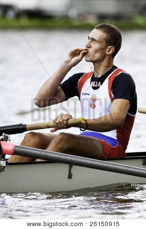 AMSTERDAM - JULY 23: Jovanovic (Serbia) kisses the cross around his neck after winning the finals at the world championships rowing under 23. On July 22, 2011 in Bosbaan, Amsterdam, Netherlands