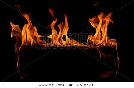 Flames wrapped around a darkened log