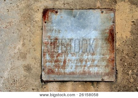 Rustic metal plate on cement for copy space