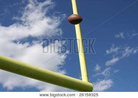Football kicked through the uprights