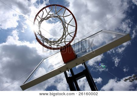 Basketball hoop with sun streak